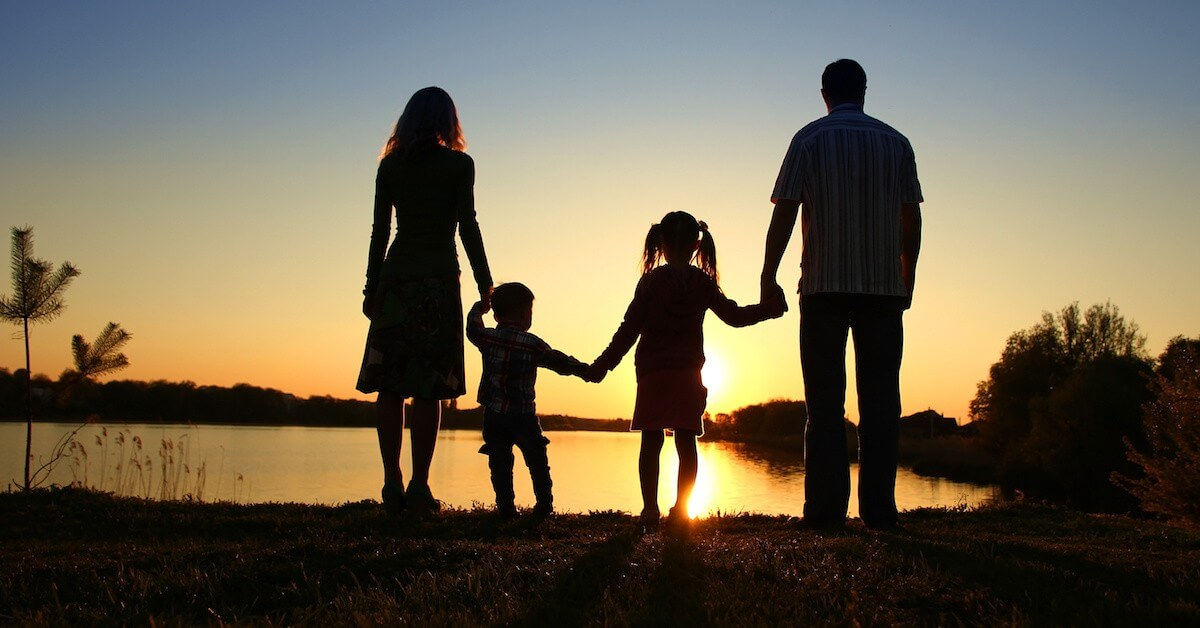 silhouette of a happy family with children