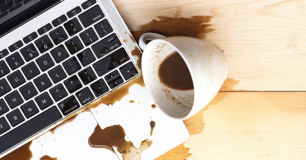 Coffee spilled on keyboard as a metaphor for fail in lawyer business development