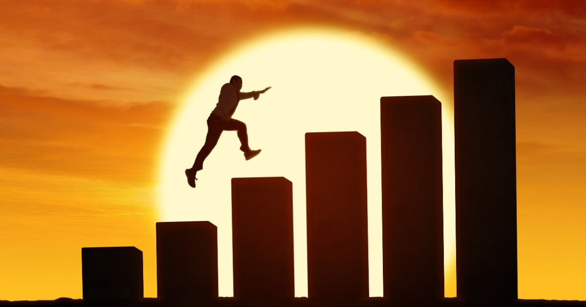 Silhouette of a person in front a the setting sun, leaping up 6 steps