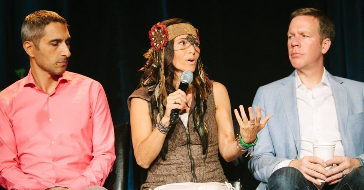 Ali Katz speaking at a conference for lawyers