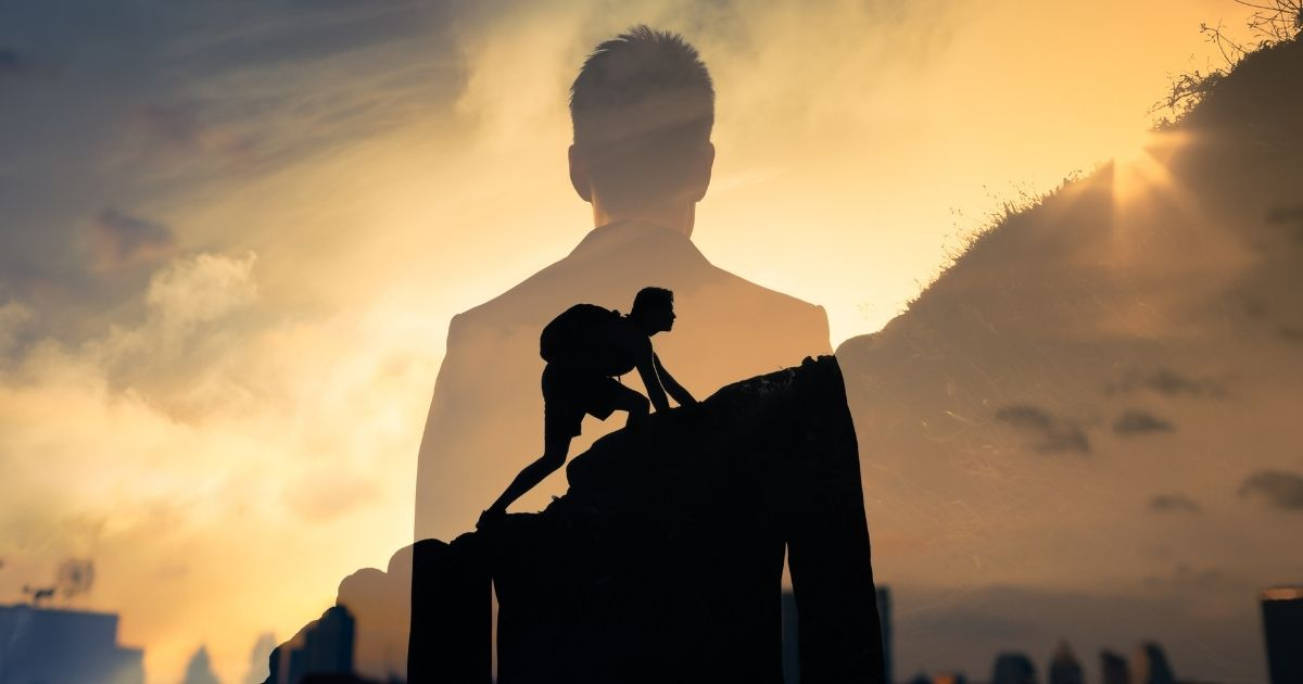 Silohuette image of professional man transparent, layed over image of man climbing a mountain.