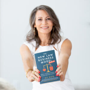 Ali Katz holds up a copy of her new book, The New Law Business Model–Revealed.