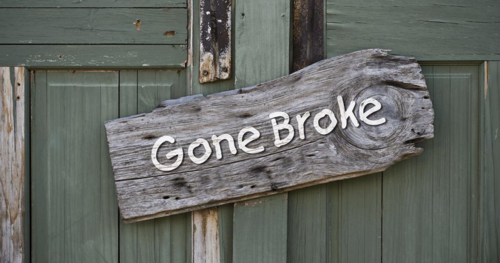 "Wooden sign on door of broke lawyers office says ""gone broke"""